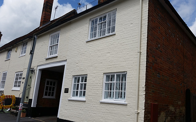 Exterior walls and refurbished windows and painted walls in exterior masonry paint finish.