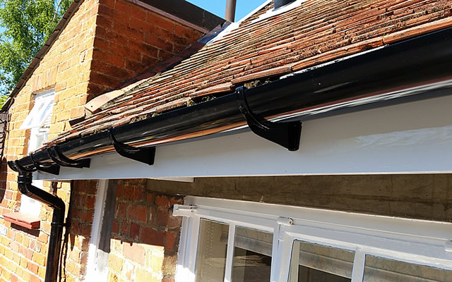 Guttering repairs and replacement of fascia board on listed building