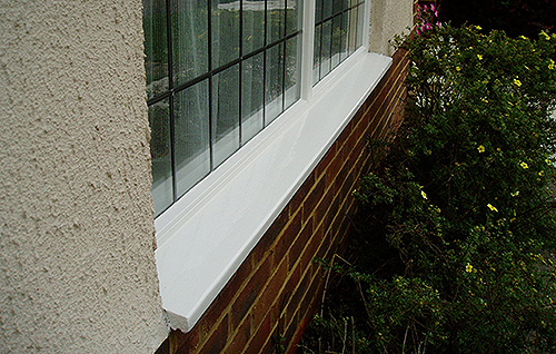 Window sill after repainting with 2 coats of microporous gloss paint