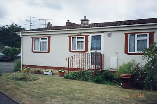 Exterior redecoration to bungalow including railings