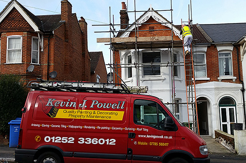 Working in a victorian property exterior, fitting and painting decorative gable-end, Aldershot