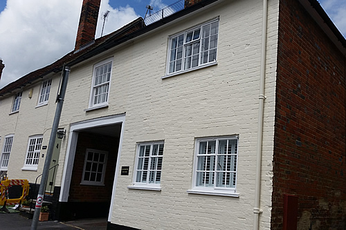 Exterior walls and refurbished windows and painted walls in exterior masonry paint finish - work in progress