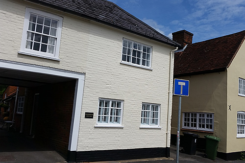 Exterior walls and refurbished windows and painted walls in exterior masonry paint finish- works complete