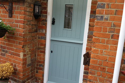 Finished stable door painted in designer paint on listed building