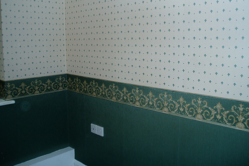 Nursing home green room in designer two-tone wall paper