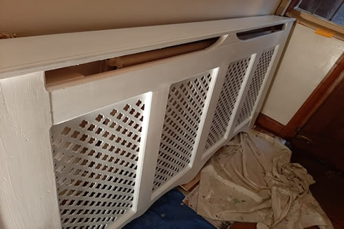 Radiator cover, from brown to white, eggshell finish.